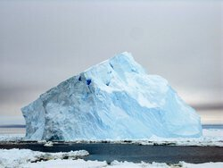 A sloped blue iceberg. Aboard the icebreaker Oden between the Amundsen and Ross seas. Photo by Lollie Garay.