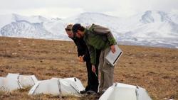 Melissa Lau and Matthew Simon take measurements at Imnaviat Creek, Alaska. Photo by Jeremy May.
