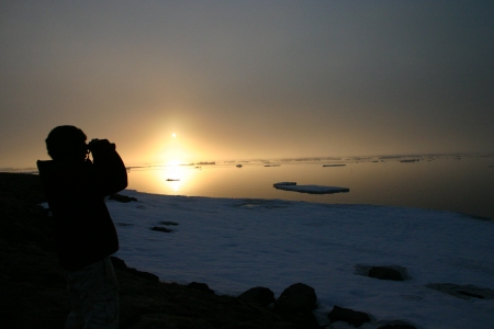 Vijay Patil does the last bird count of the evening. Savoonga, St. Lawrence Island, Alaska. Photo by Lisa Sheffield Guy.
