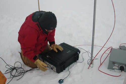 Sam checking up the data acquisition modules (DAQs).