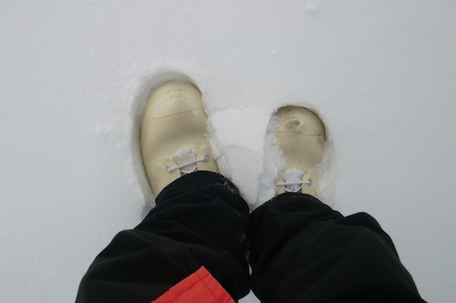 Boots sinking into the snow.