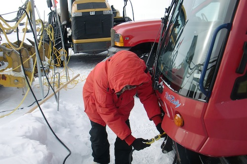 Back after three and a half hours.  Me plugging in the snowmobile's engine block heater.