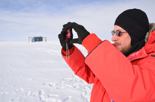 January 15: Taking a photograph during an IceTop outing.  Credit: Hans Niederhausen.