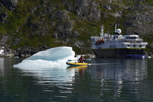 Bergy Bit, Kayaker, and NG Explorer, Skjoldungesund, Greenland