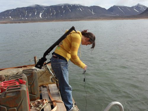 Kamilla checking the water temperature.