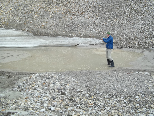 John pointing to the sinkhole