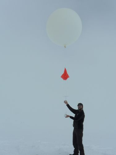 NOAA scientist prepared to launch weather balloon