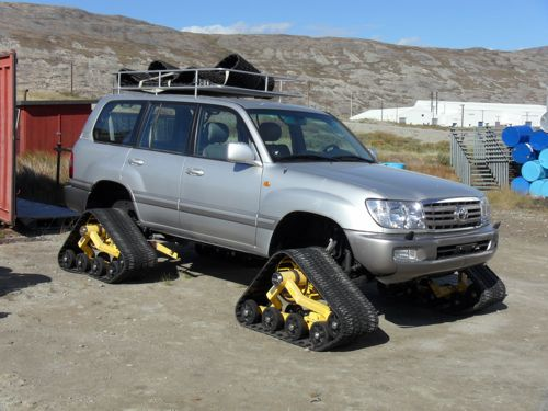 All-terrain vehicle with tracks.