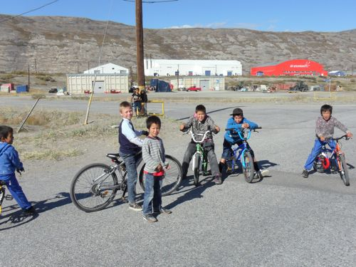 Local kids riding bikes and playing.