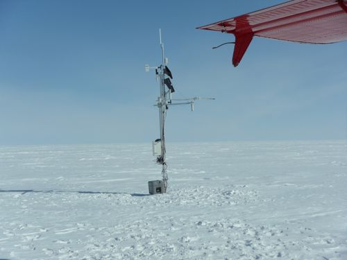 Serviced Humboldt AWS with battery on snow surface.