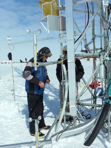 Koni and Simon working on instruments mounted on the Swiss Tower