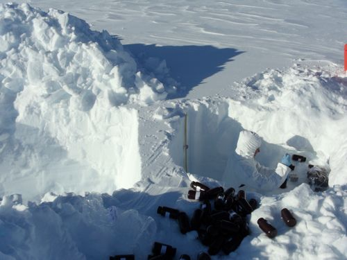 Two snow pits, side by side to create a back-lit snow profile.
