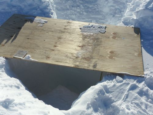 Snow pit with plywood cover