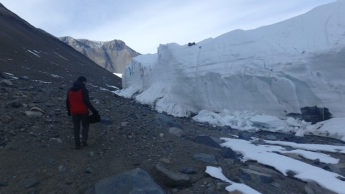 Scott George hikes along the Canada Glacier.