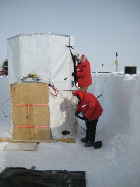 James Roth and Tom Gaisser setup the sunshades.