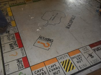 Macopoly board painted on the floor of the Berg Field Center.