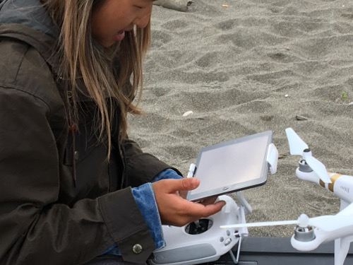 Jennifer goes through pre-flight checks between the drone and her tablet.