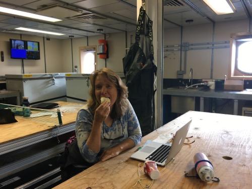 Lisa Seff eating a cinnamon bun.