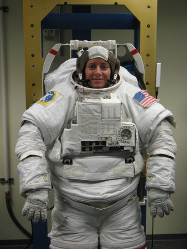 an astronaut in her space suit weighs 300 - photo #6