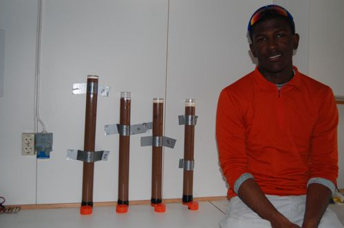 Daren sitting next to some of the sediment cores