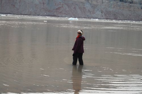 Daksha wades into the fjord.