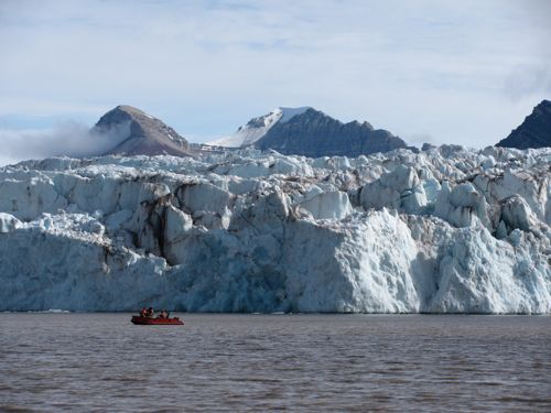 boat in front of glacier