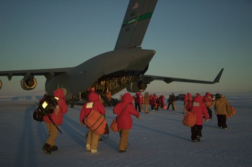 Passengers boarding the C-17