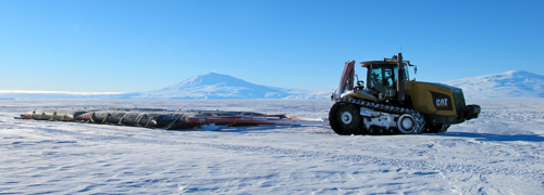 Vehicle pulling fuel in traverse to South Pole