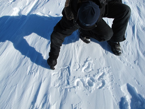 South Pole written in snow to show where it has moved to.