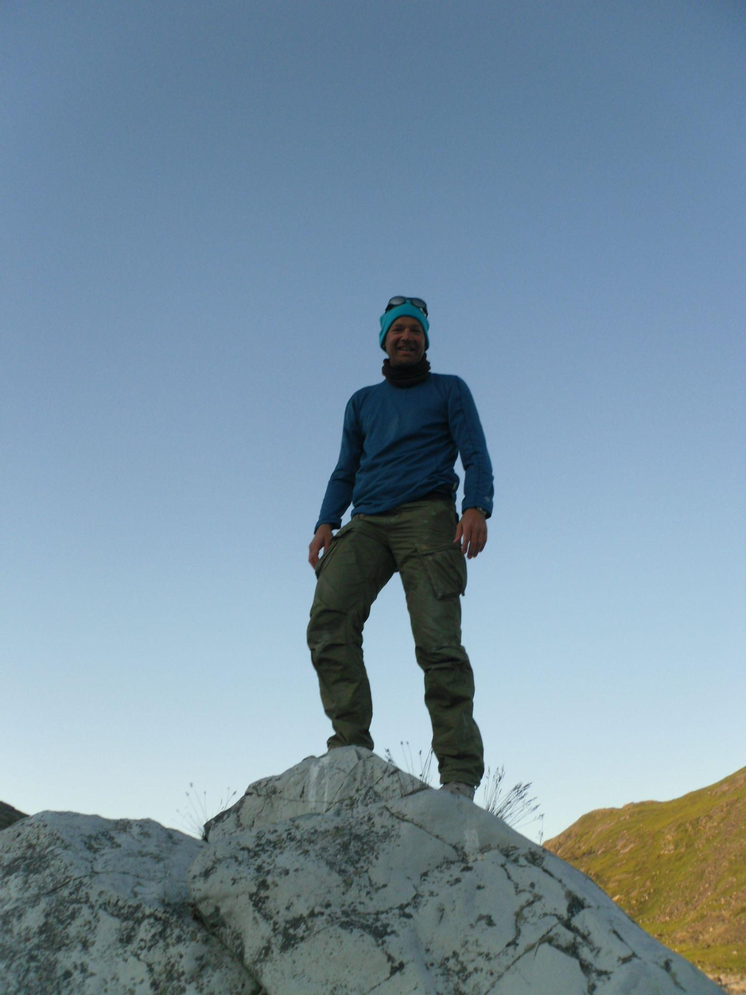 Torben Benoni on a large rock near the waterfall