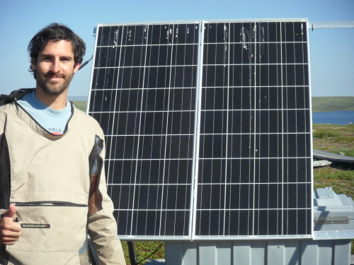 Jose with the solar panel that powers the motor for the trolley