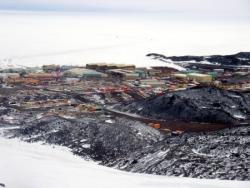 A view of McMurdo Station from above at the former grounds of the nuclear power plant. Looking out over the harbor and McMurdo Sound, Antarctica.