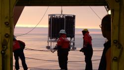 The crew readys the CTD at dusk aboard the USCGC Healy icebreaker. Photo by Andrea Skloss.