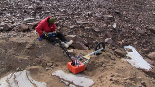 Photograph of Sean Mackay and GPR instrument
