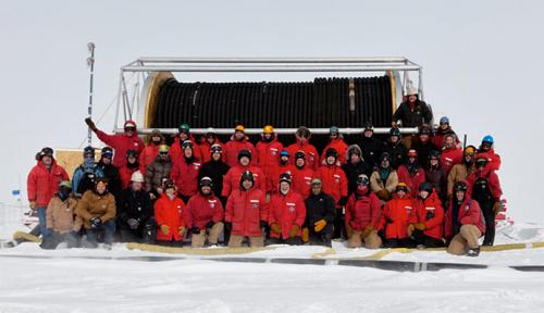 The whole IceCube team poses for a picture by the drill hose.