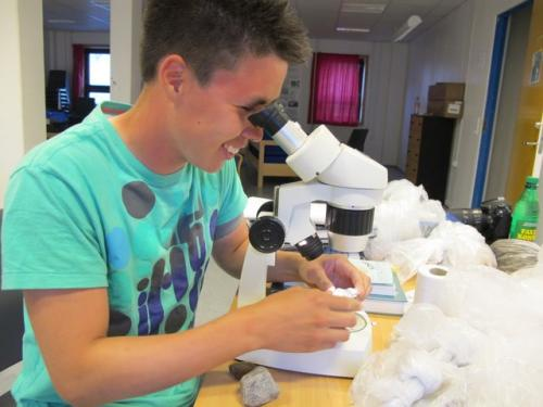Ole examines minerals found in metamorphic rock samples