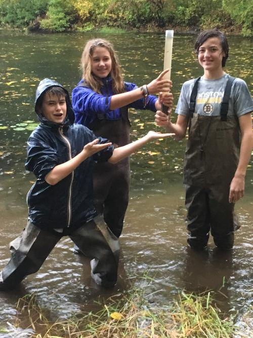 Students collecting sediment