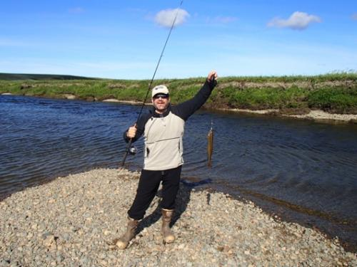Mark catches his second Arctic Grayling fish.