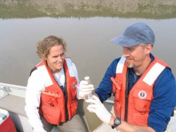 Teacher Amy Clapp and researcher Max Holmes process samples from the Mackenzie R