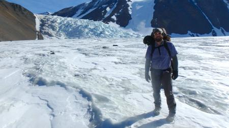 PolarTREC teacher Josh Heward stands in front of the ice falls on Canada Glacier in Taylor Valley, Antarctica