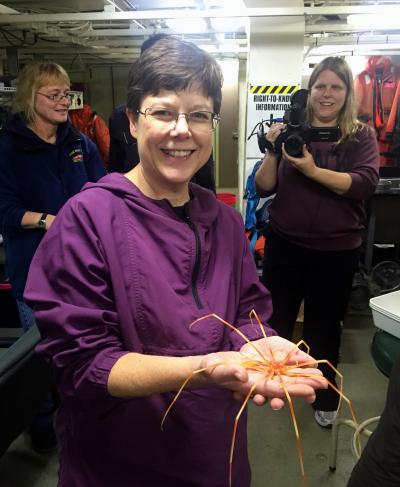 Sandra Thornton holds a sea spider