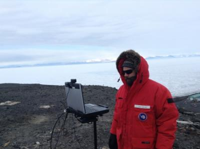 Josh Heward tests equipment in preparation for his upcoming PolarConnect event. Observation Hill, McMurdo Station, Antarctica. Credit to Read:  Photo by Jim Madsen, Courtesy of Joshua Heward (PolarTREC 2016), Courtesy of ARCUS