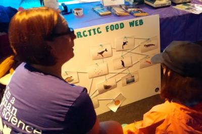 Cara at Mystic Aquarium Women in Science Day talking to a student.