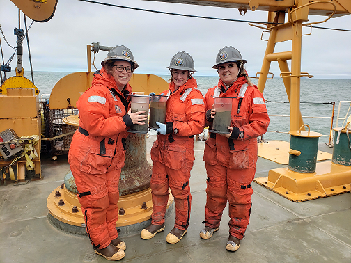 Christina Goethl, Nicole Villeneuve, and Piper Bartlett-Browne holding HAPs cores. (Photo courtesy of Dr. Lee Cooper)