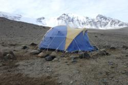 Boulders around the tent keep it anchored down in strong winds. Lake Bonney, Antarctica.