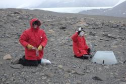 Dr. Thomas Powers and Natasha Griffin collect soil samples at the F6 site in the McMurdo Dry Valleys, Antarctica.