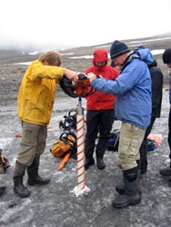 Taking an ice core of a glacier on Svalbard