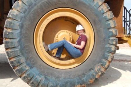 Andrea siting on the rim of a tire.
