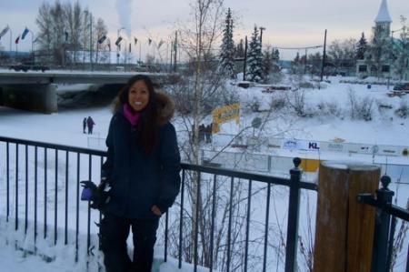 Cristina Solis standing next to the Chena River.