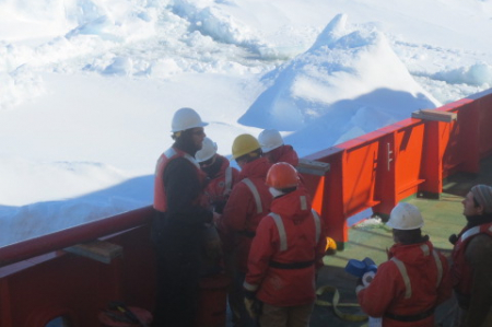 Scientists and techs on deck preparing a jumbo piston core